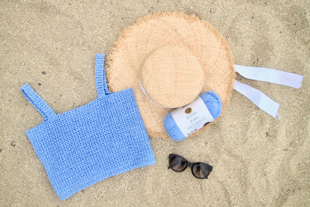 square neck crochet crop top pattern on top of sand and straw hat