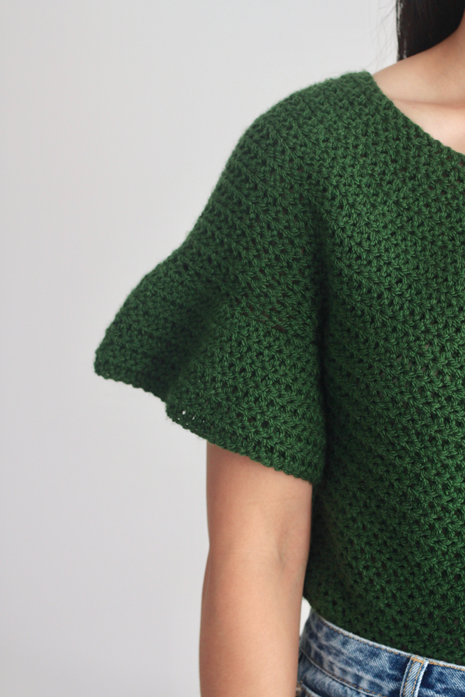 close up on ruffle sleeve of easy crochet top pattern