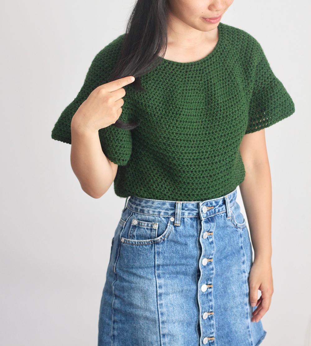 green crochet top with denim skirt