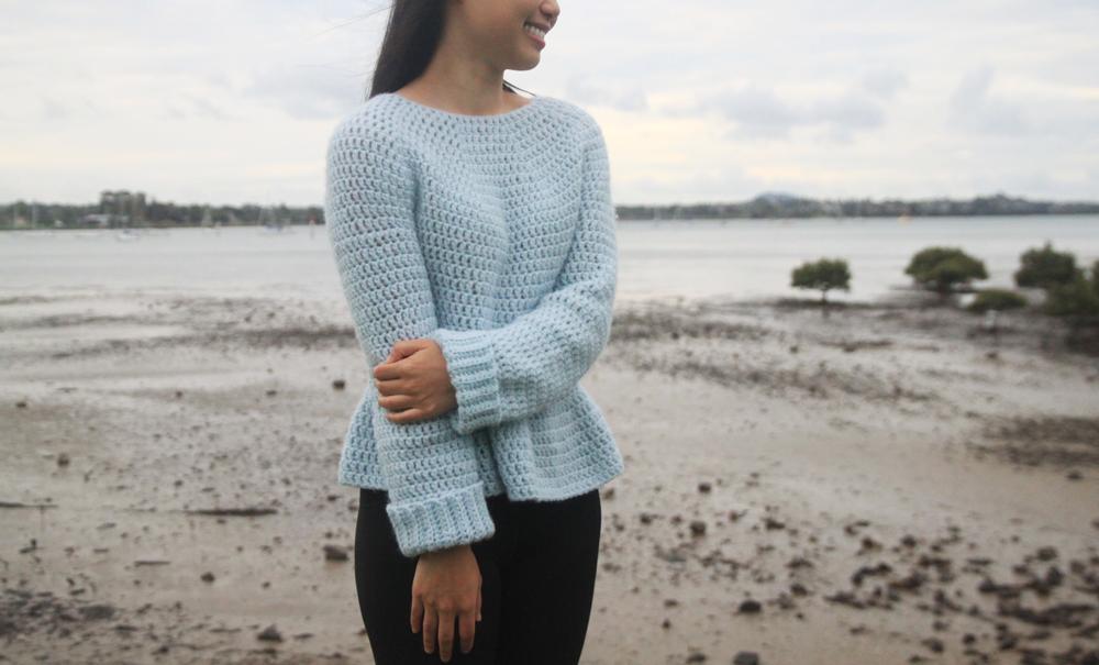 blue crochet peplum sweater beach background