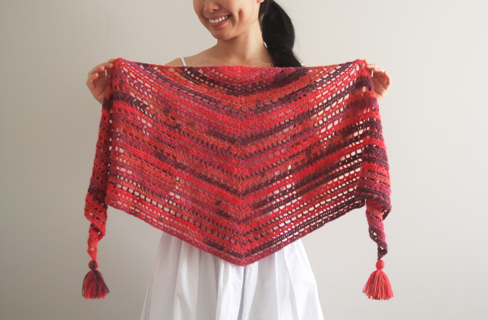 mesh triangle crochet shawl with tassels in variegated yarn