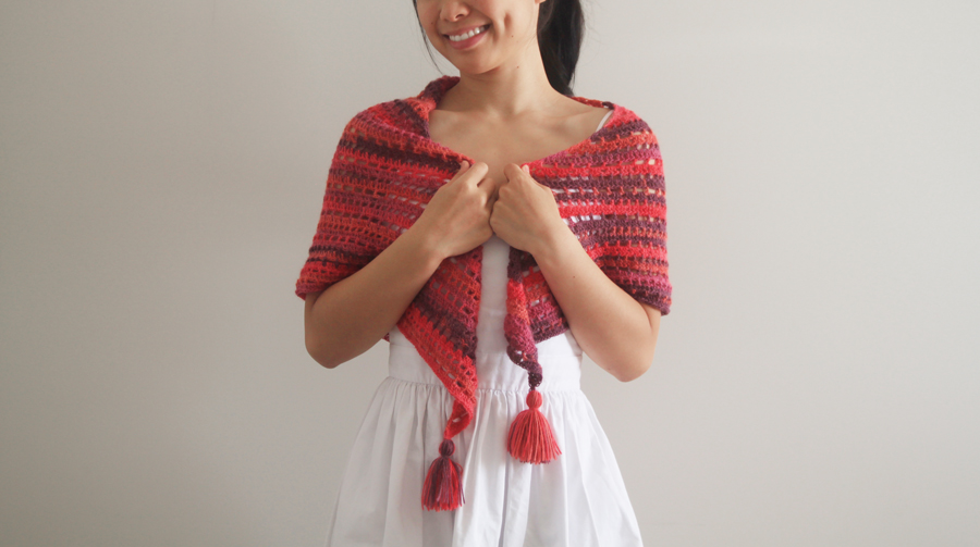 triangle crochet shawl wrapped around woman