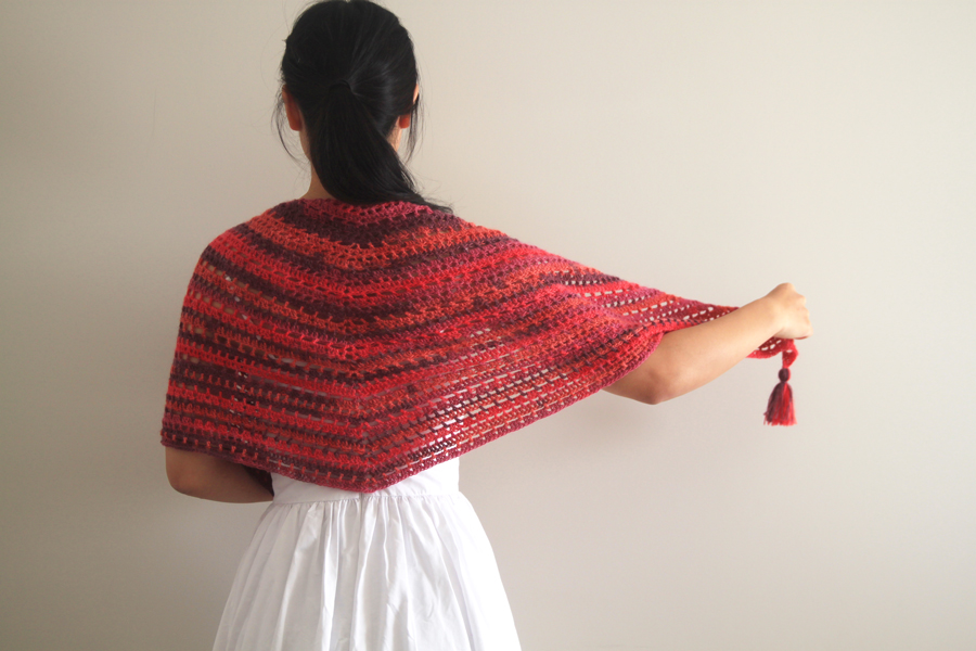 pink, orange, red triangle crochet shawl with tassels