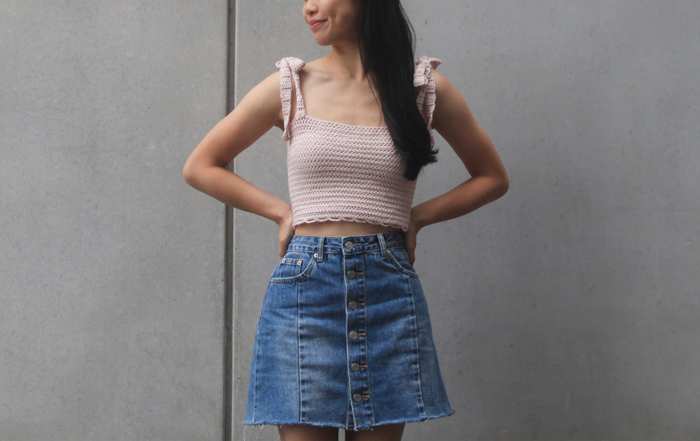 woman wearing handmade crochet tank top with tie straps and denim skirt
