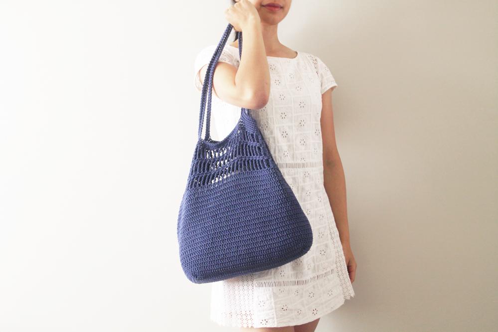 woman holding easy crochet tote bag