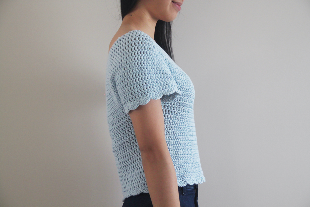 side view of crochet top with scallop edged sleeves