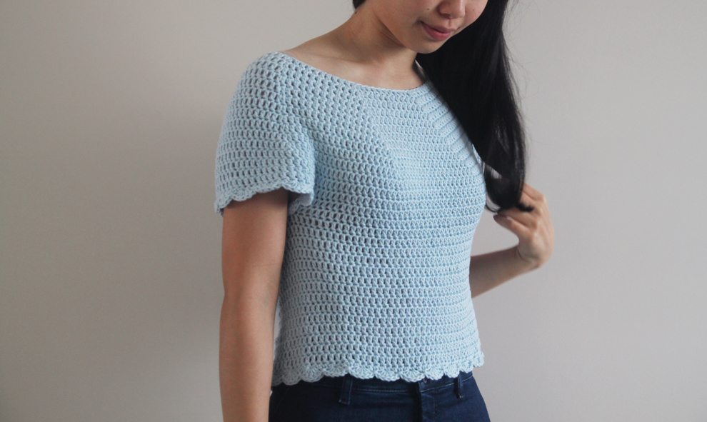 3/4 view of scallop hem crochet tee