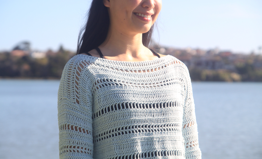 close up on mesh stitches of summer crochet pullover