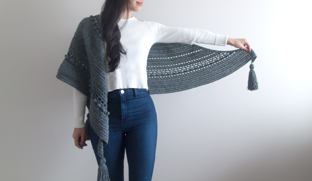 gray crochet wrap with mesh, bobbles and chunky tassels, worn with white long sleeve and jeans