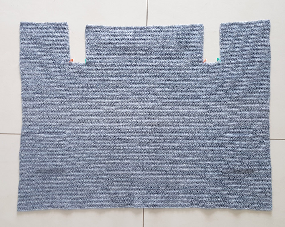 body of crochet cardigan with hidden pockets