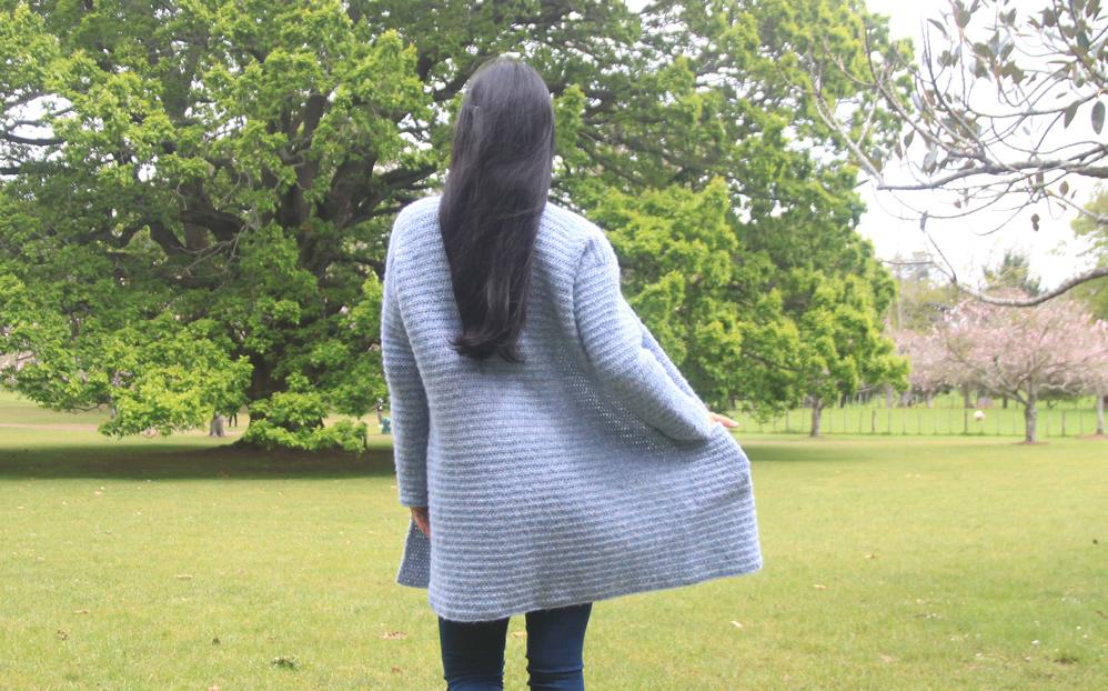 back view of crochet coat with hidden pockets