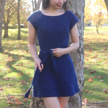 blue crochet dress with cap sleeves tie belt fit and flare style