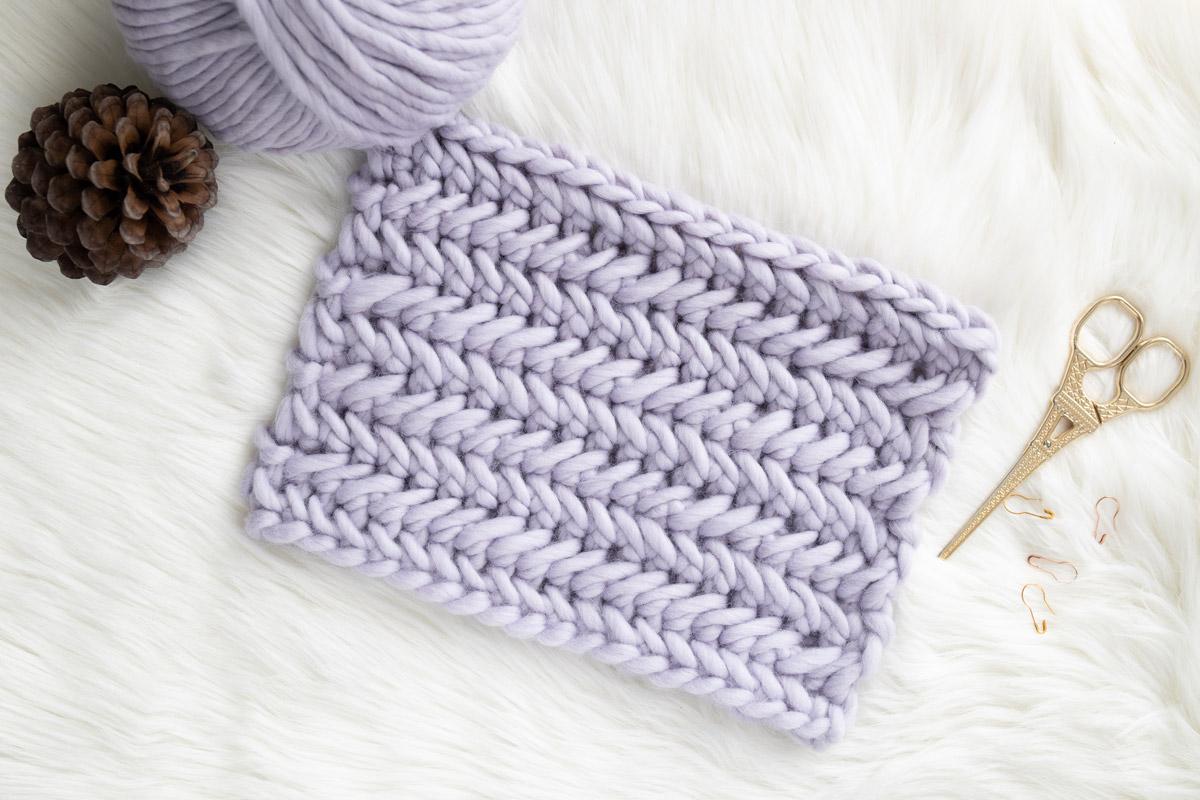 flat lay of the herringbone single crochet stitch that looks like knit