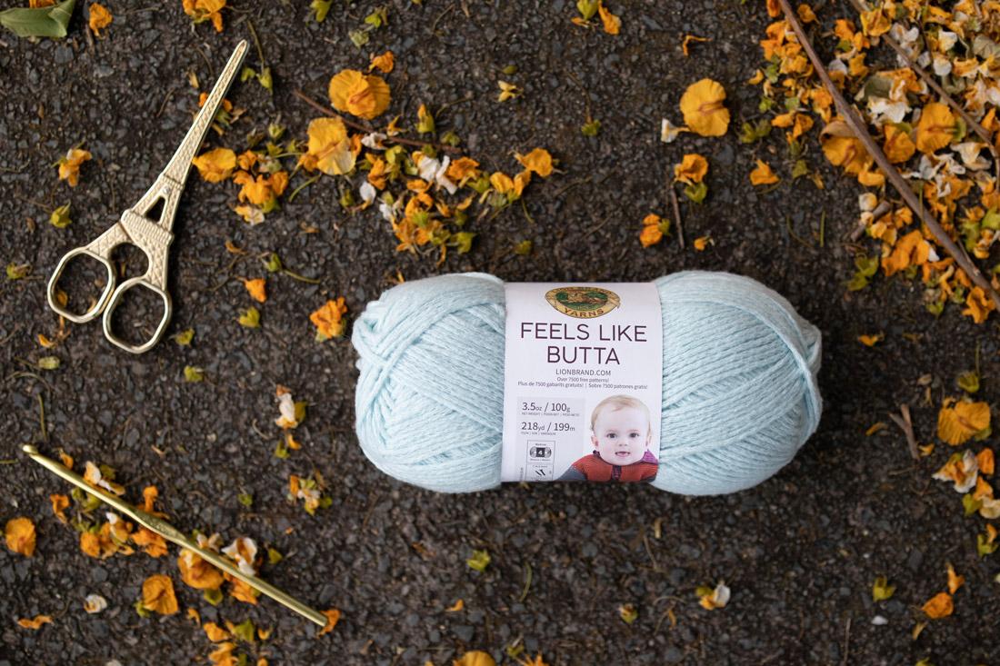 lion brand yarns feels like butter ice pale aqua gold scissors crochet hook