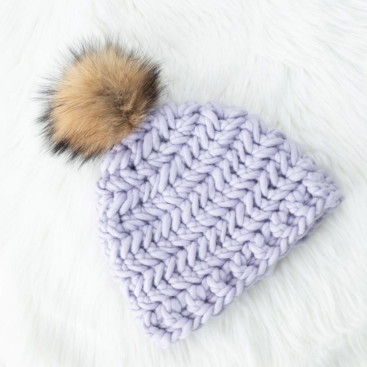 purple chevron crochet beanie with faux fur pom pom on sheep skin