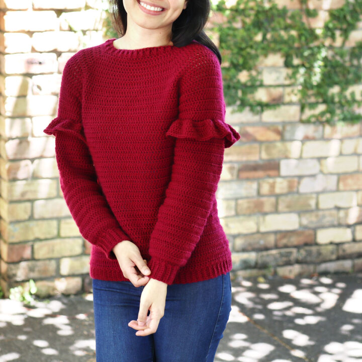 red crochet christmas sweater with ruffles