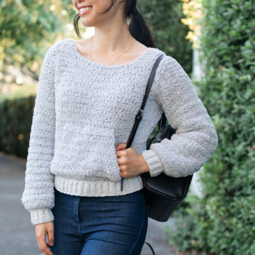 fuzzy teddy fleece sweater light grey free crochet pattern with black leather backpack blue jeans