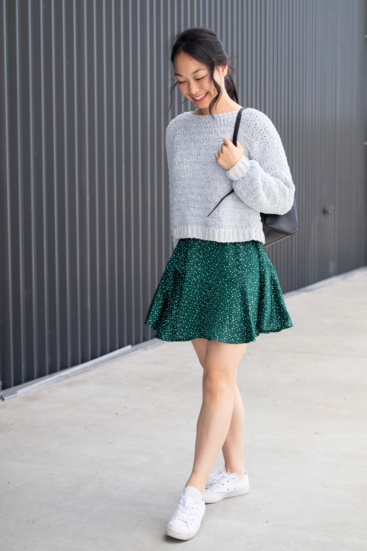 cosy teddy fleece sweater with green dress and backpack white converse shoes
