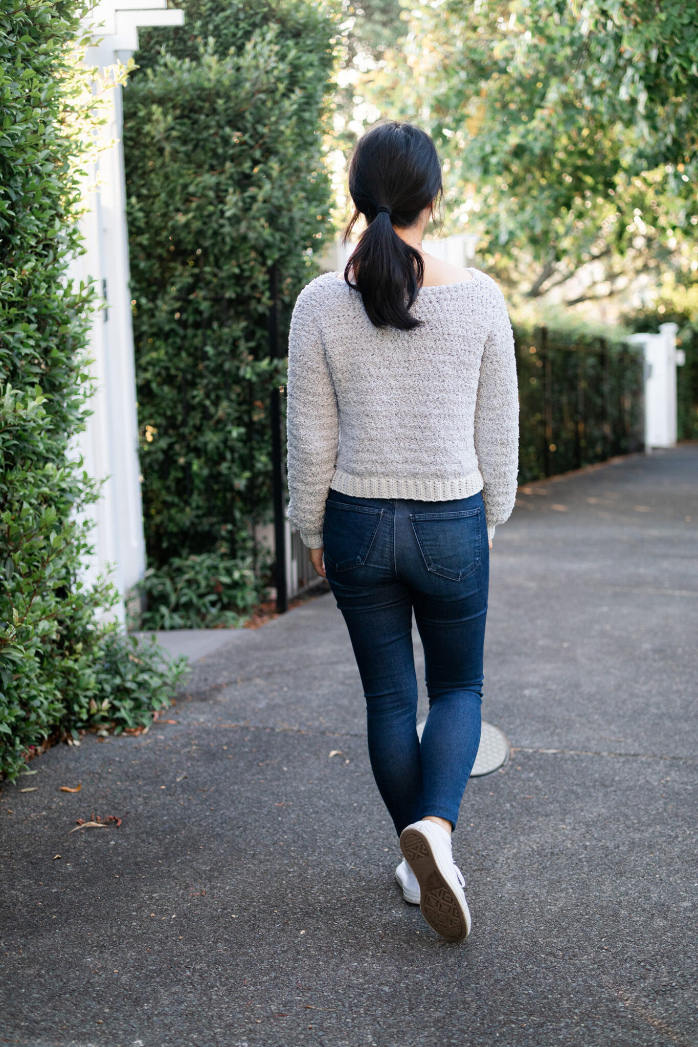 back view of fuzzy light grey teddy sweater with blue jeans free crochet pattern