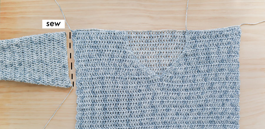 sewing sleeve to body of v neck crochet sweater