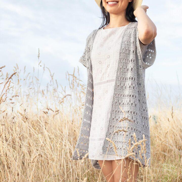 light grey summer cardigan mesh details in a field