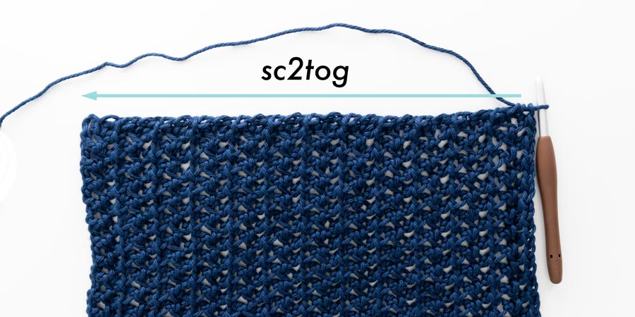 single crochet two stitches together along edge of crochet cover up sleeve