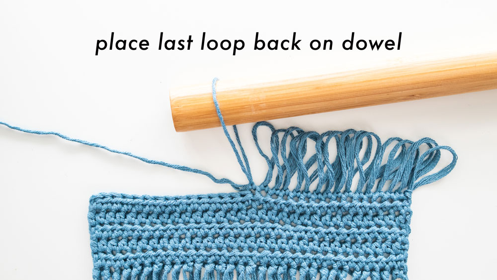 slide last crochet loop back onto dowel