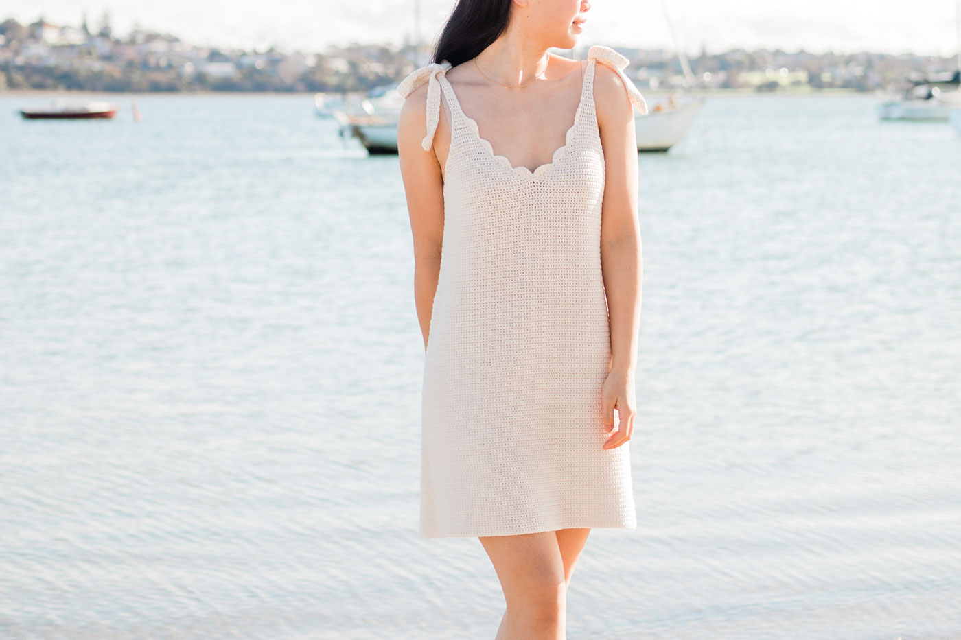 v neck summer crochet dress with scallop stitch edging and bow tie straps