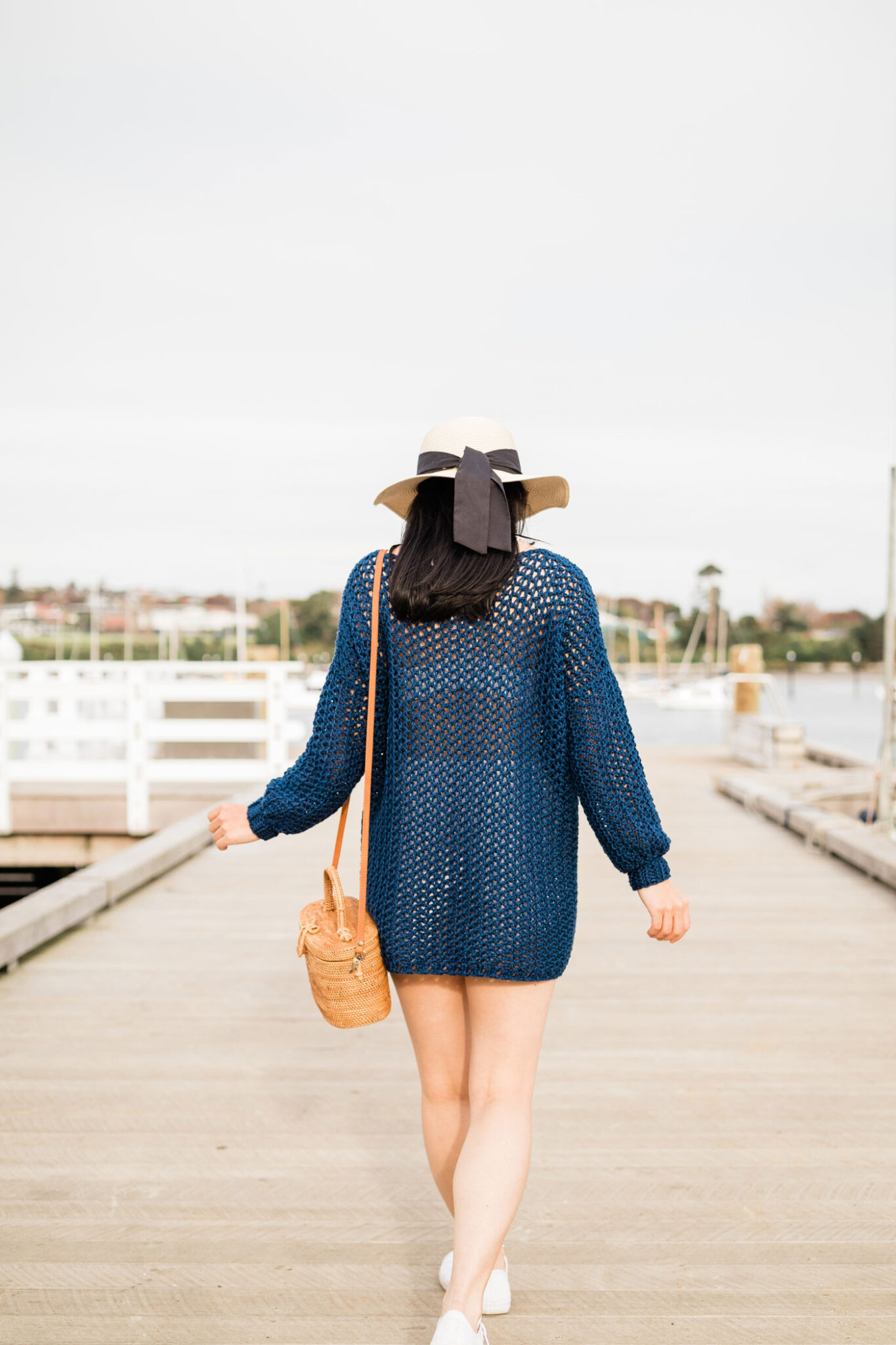back view of navy mesh crochet cover up sweater