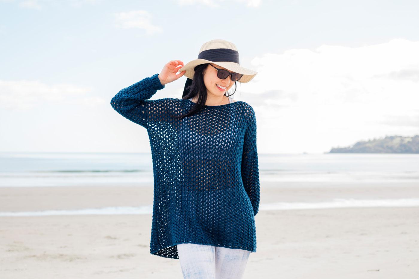 oversized mesh crochet cover up on the beach