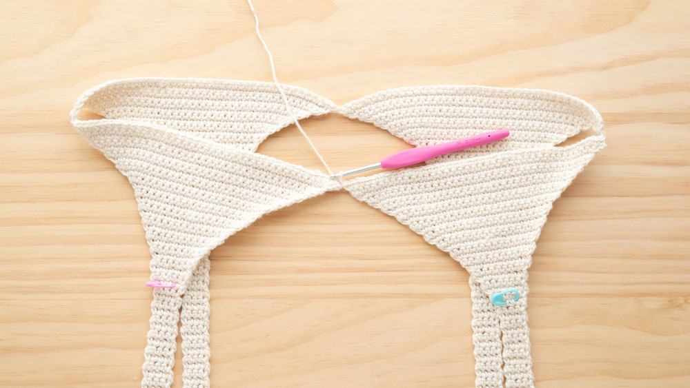 four crochet triangles joined into a tank top