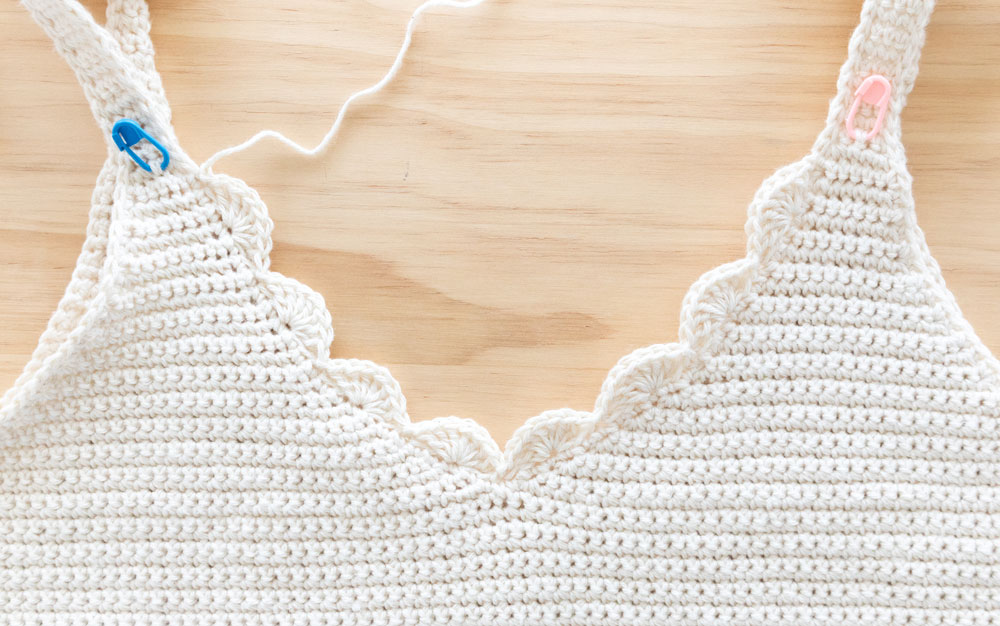 close up of crochet camisole with scallop stitch v neck