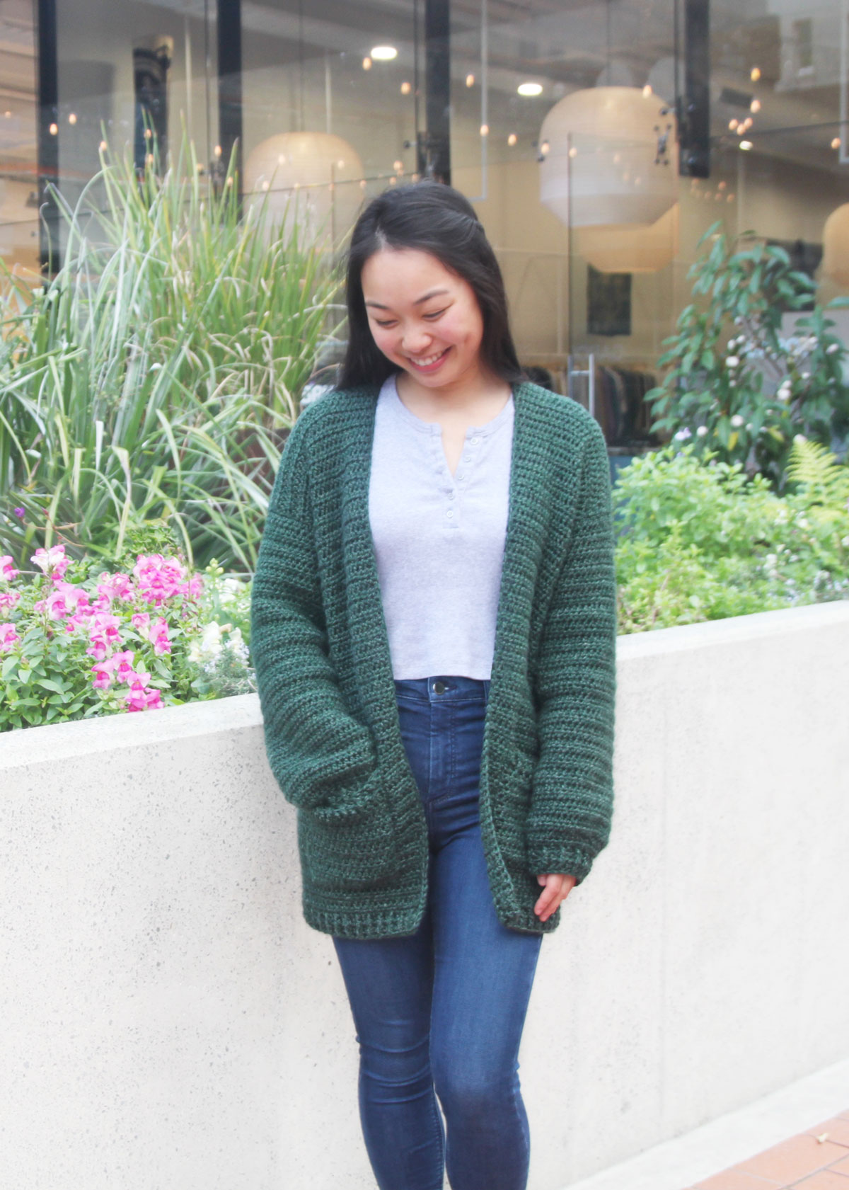 loose crochet cardigan with pockets and jeans