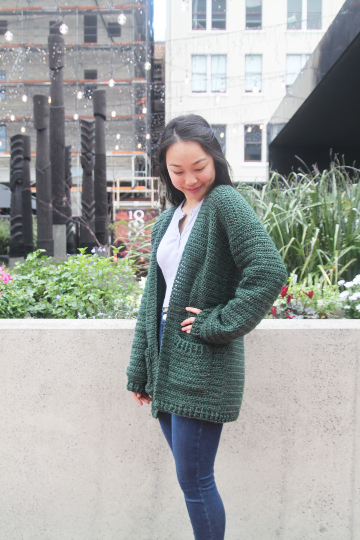 long oversized crochet cardigan with pockets and ribbing