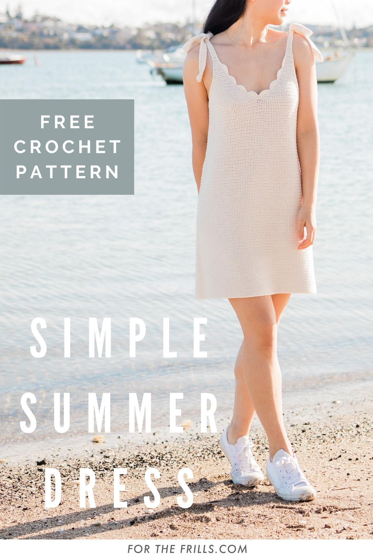 pin of crochet summer dress with scallop v-neckline and tie straps with woman standing on the beach
