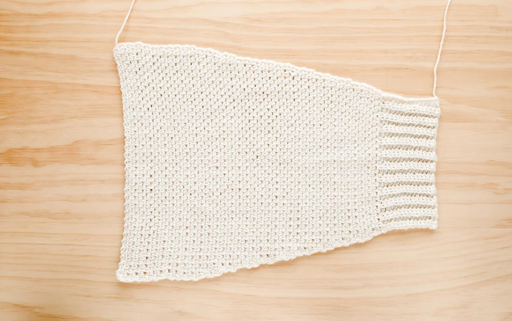 tapered crochet sleeve in moss stitch with back loop half double crochet ribbing