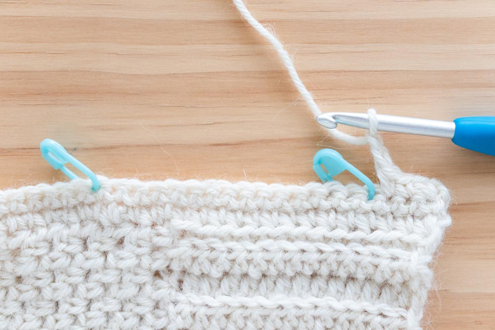 close up of crochet button hole by chaining 2 stitches and skipping 2 stitches