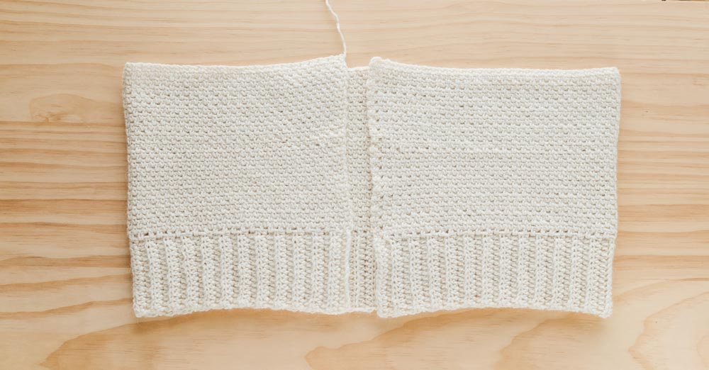 close up of crochet cardigan body panel in linen stitch with back loop half double crochet ribbing