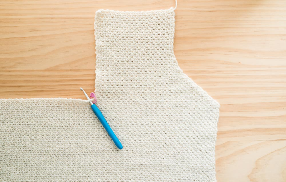 close up of first front panel of button down crochet cardigan