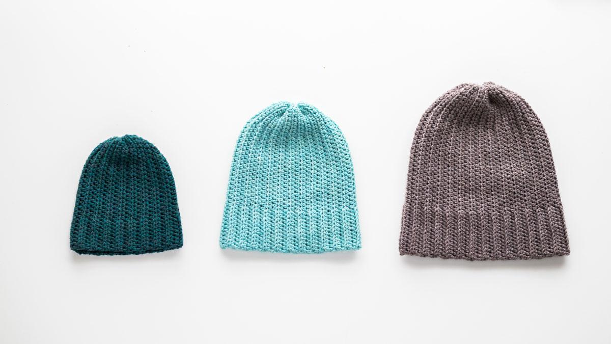 dark green toddler crochet beanie, light blue simple child beanie and brown grey adult beanie