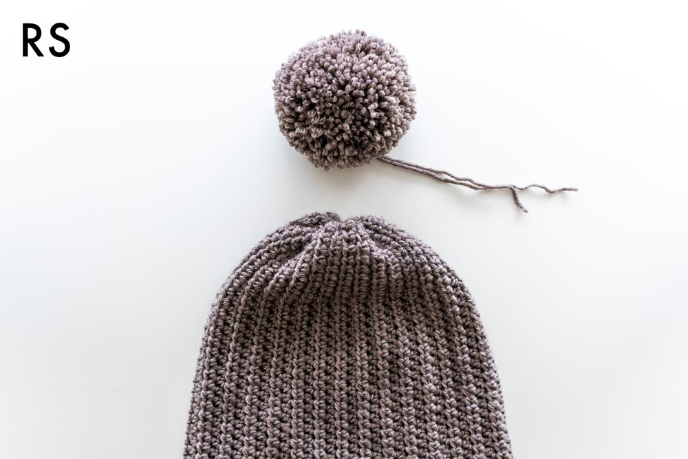 attach yarn pom pom to crochet beanie