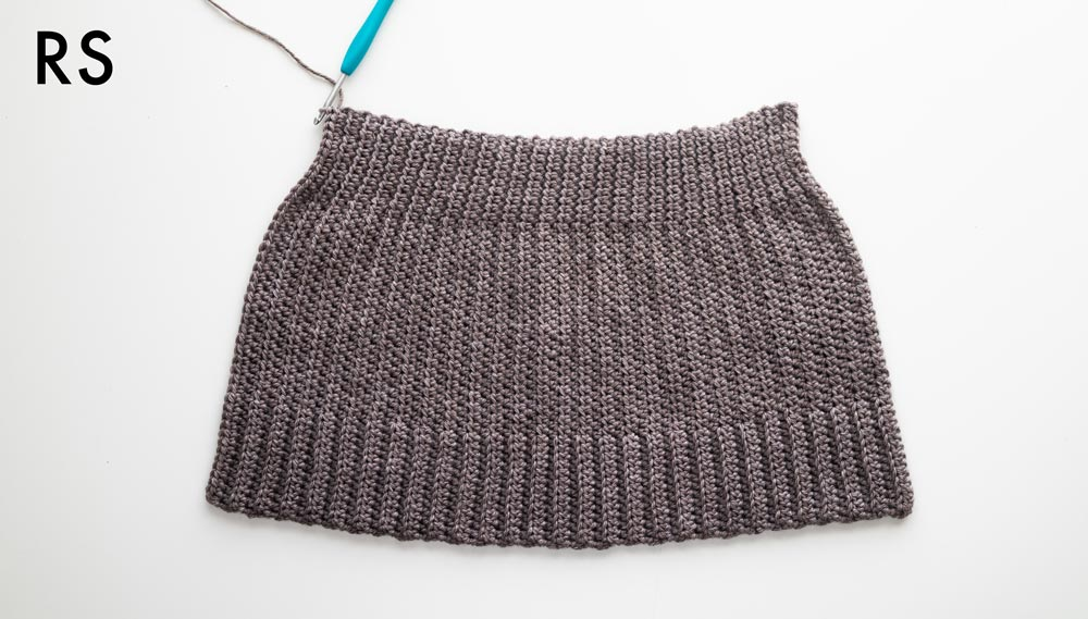 right side of trapeze crochet beanie with smooth stitches at the top