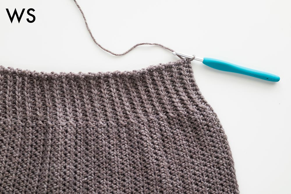 close up of ridged half double crochets at top of tapered crochet beanie