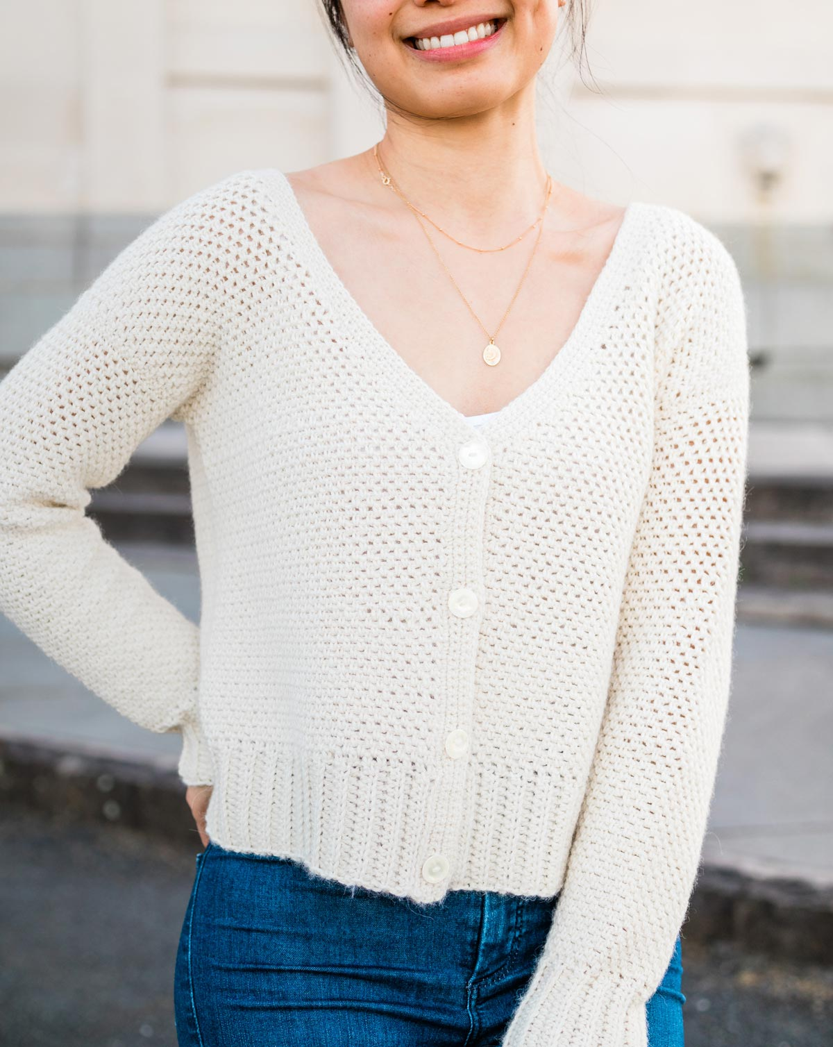 modern cream crochet cardigan with buttons
