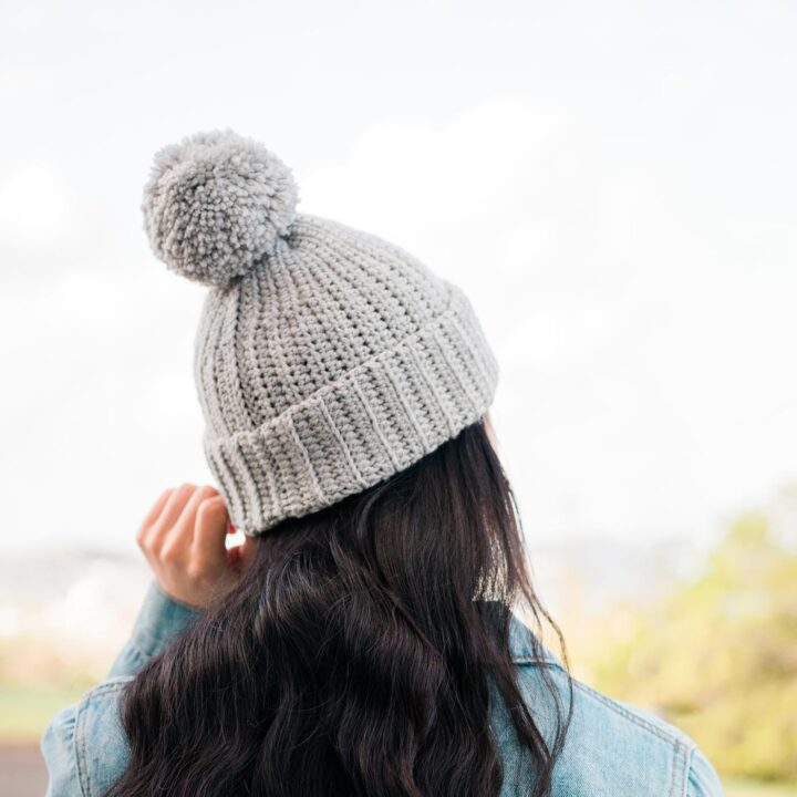 grey crochet beanie with folded ribbed knit look brim and pom pom