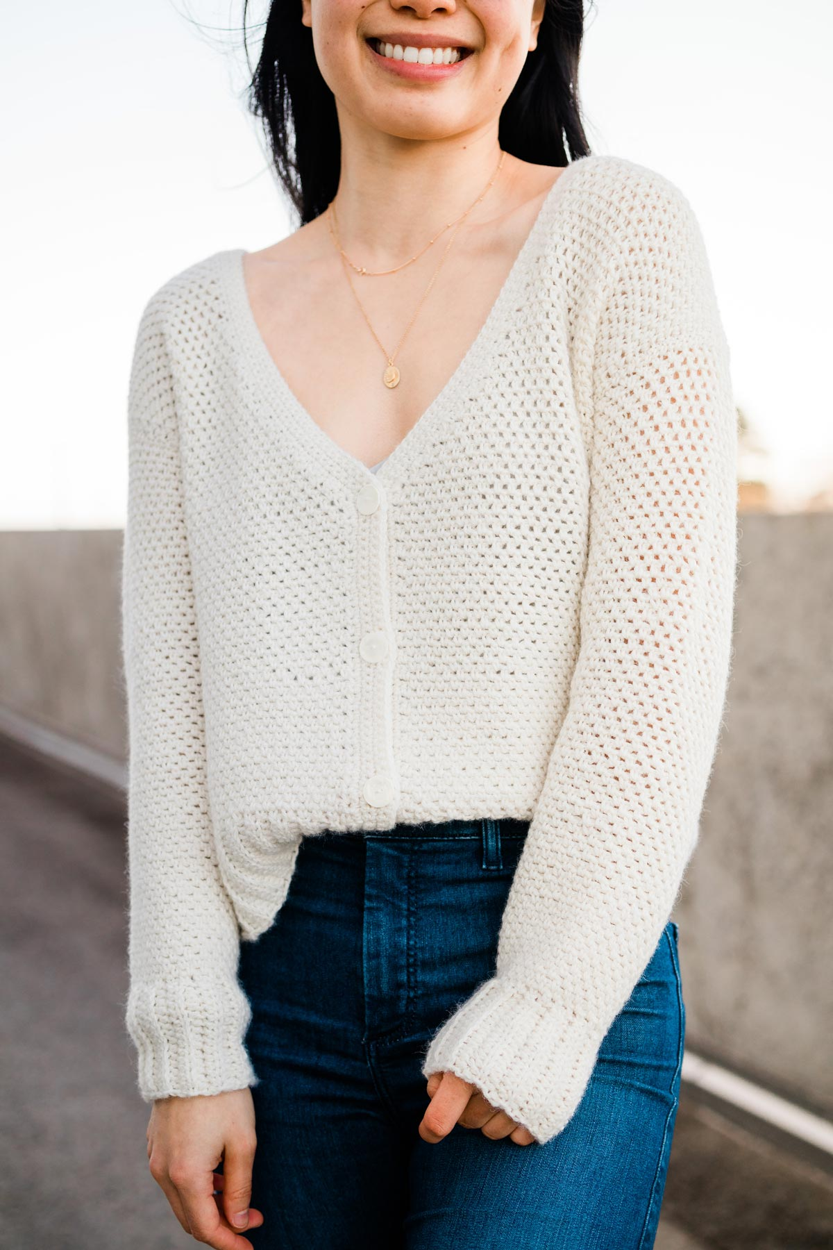 v-neck button down cardigan in baby alpaca yarn paired with blue jeans
