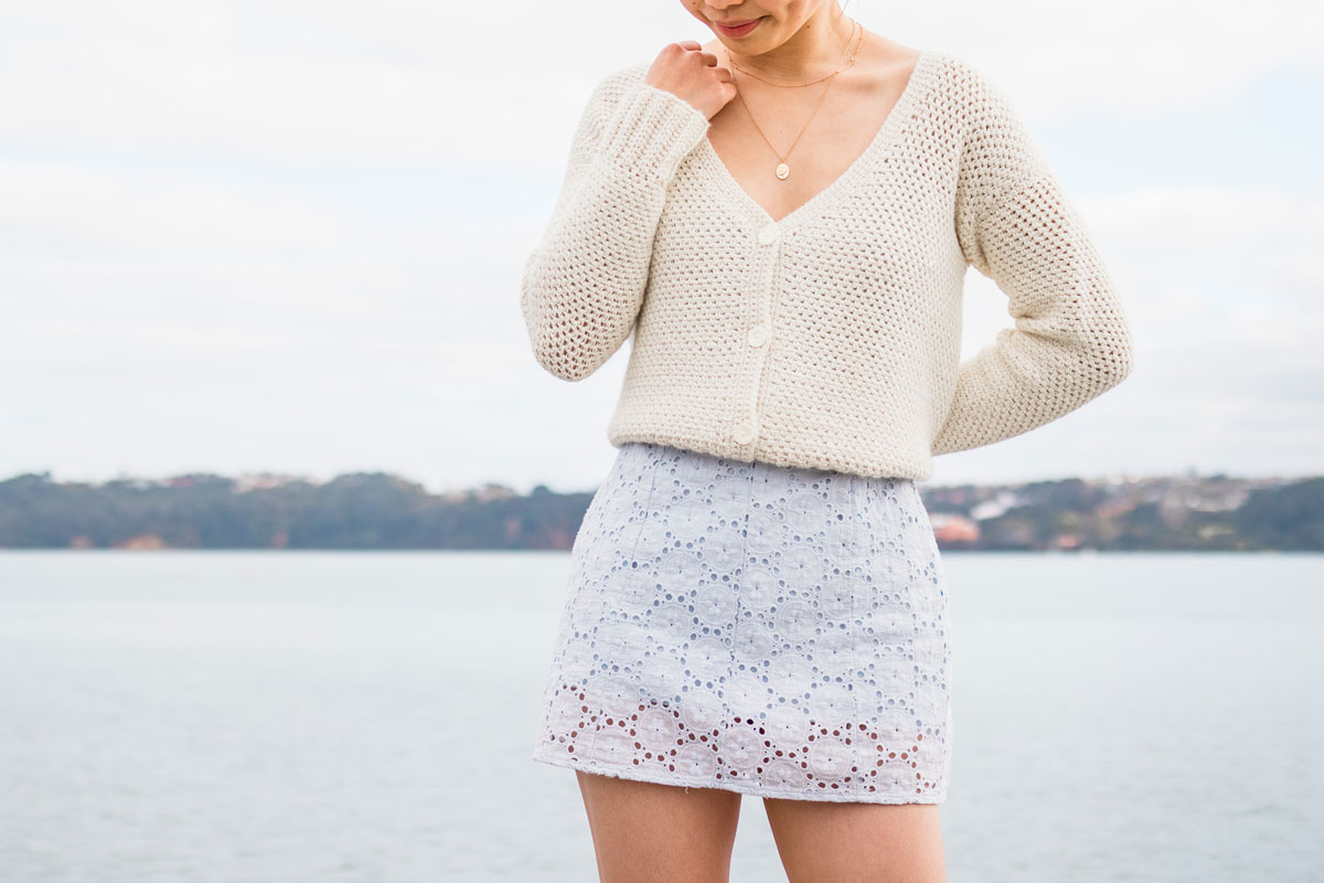 cropped button down crochet cardigan in baby alpaca yarn worn over lavender broderie dress