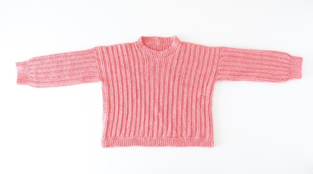 flat lay of ribbed crochet sweater with hemline slip stitch ribbing