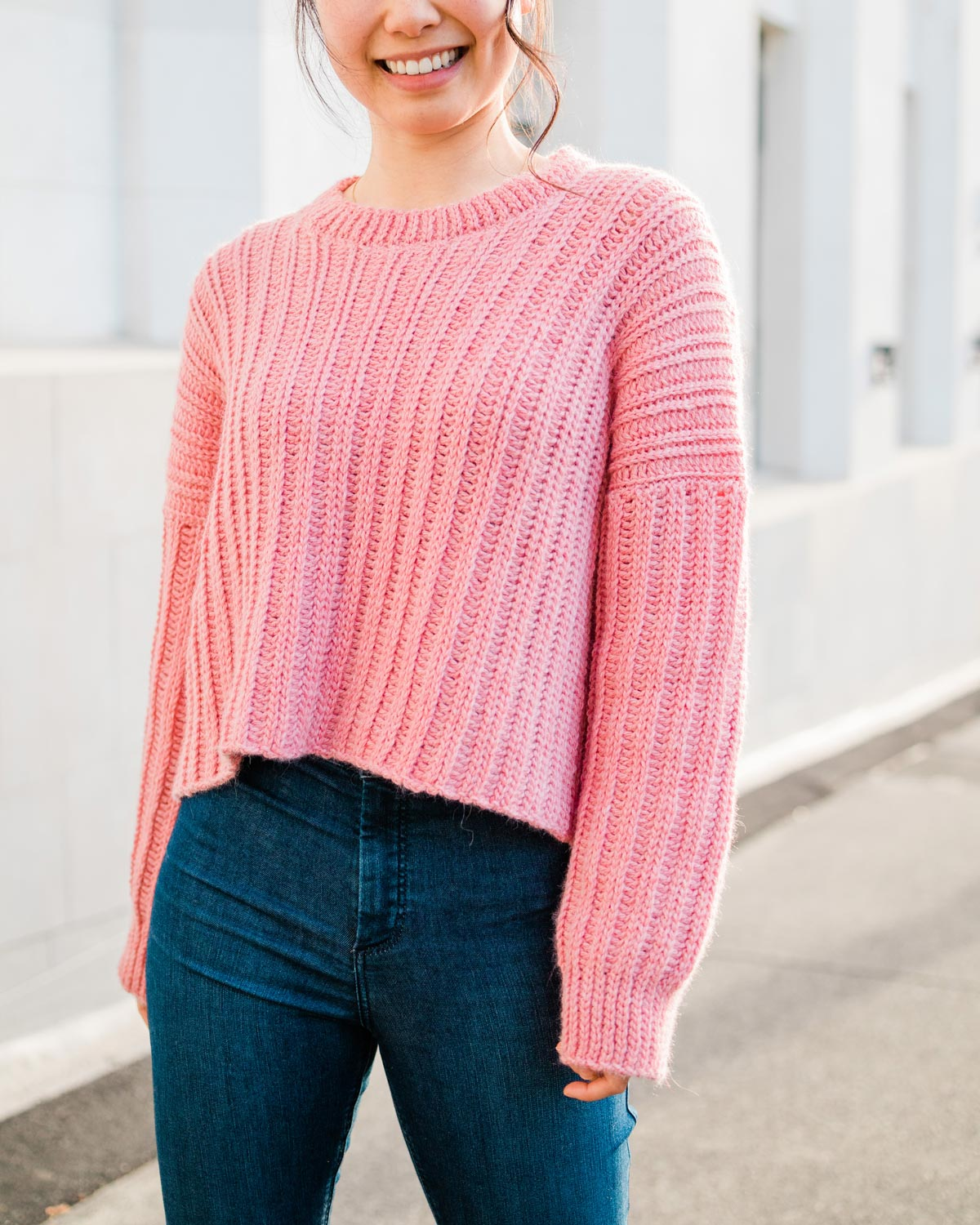 ribbed crochet crop sweater with long sleeves and blue jeans