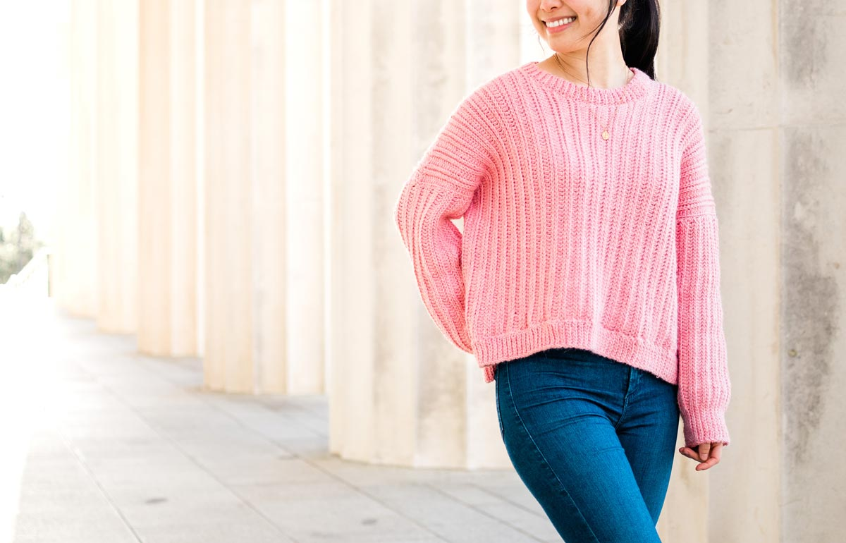 ribbed crew neck crochet pullover with hemline ribbing and loose fit